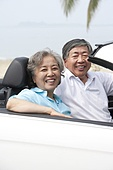 Happy Senior Couple Posing in a Convertible