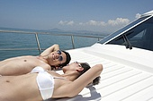 Man and Woman Relaxing on a Yacht