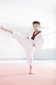 Cute boy practicing Tae Kwon Do