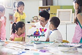Little children in art class with teacher