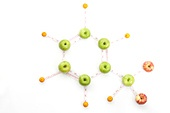 Fruits and measuring tape in molecular structure