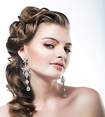 Delight. Elegant Posh Woman Bride with Diamond Earrings. Platinum Jewelry