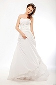 Beautiful bride in luxurious white wedding long dress posing