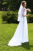 Young bride in park
