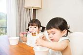 Little girl eating Yogurt