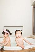 Child bathing in bathroom