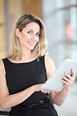 Businesswoman using electronic tab