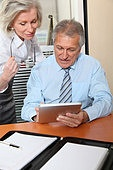 Senior business people in the office with electronic pad