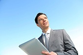 Portrait of businessman working on electronic tablet