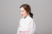 young woman wearing a hanbok and smiling