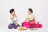 Couple making food on Korean holiday