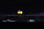 Full Moon rise over Bosphorus Bridge, Istanbul City, Turkey