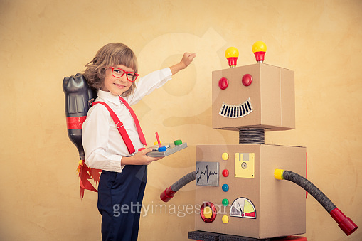 Kid with Toy Robot