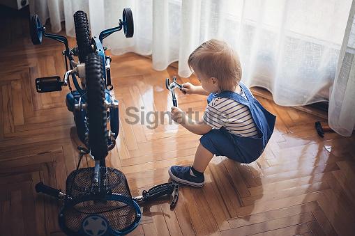 Baby repairing bicycle