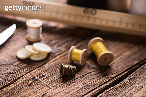 Sewing tools on wooden table