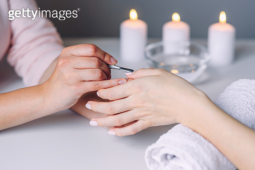 Woman hands getting manicure