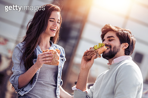 Couple eating sandwich