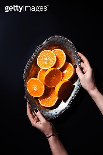 Mandarin on black surface