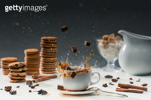 Brown sugar cubes and coffee cup