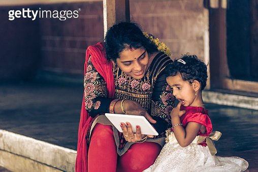 Mother teaching, India