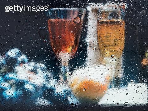behind wet glass