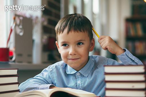 Boy enjoying books