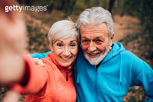 Senior couple making a selfie in a park