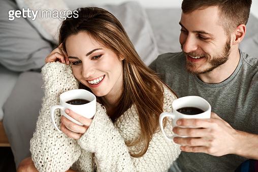 Cheerful couple drinking coffee