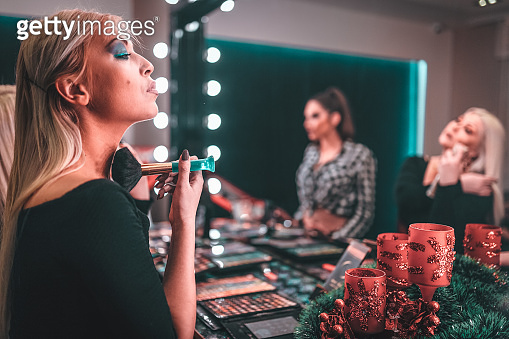 friends applying make-up