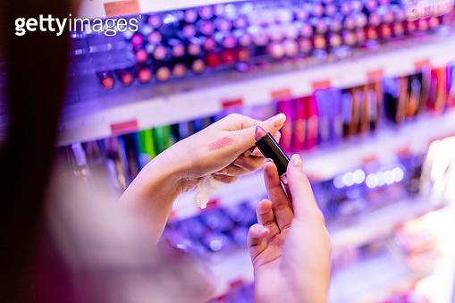 Choosing lipstick at department store