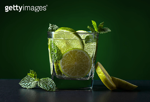 Lemon, lime, rum, ice and peppermint.