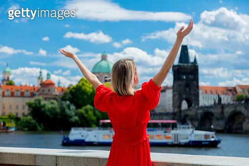 Red dress girl in Prague