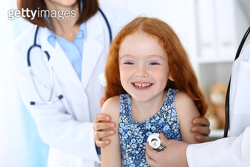 Doctor examining a little girl