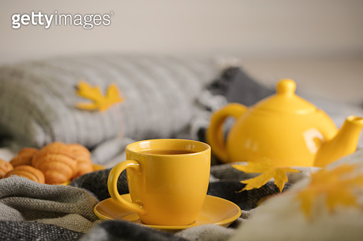 Tea and autumn maple leaves
