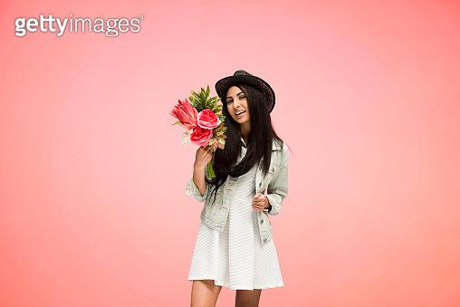 Beautiful female on pink background