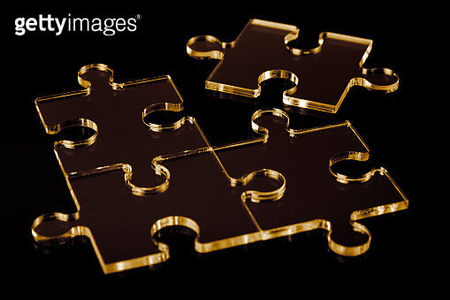 abstract puzzle pieces on black background