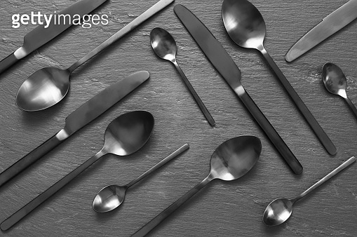 Black silverware on slate