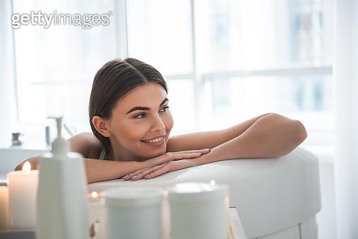 Woman resting in bathroom in room