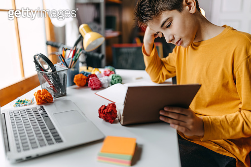 Kid writing homework in his room