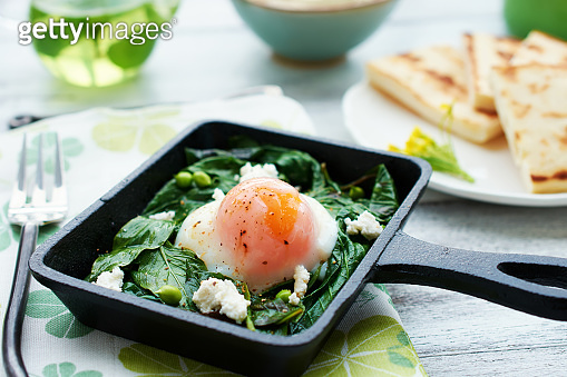 poached egg with spinach, basil