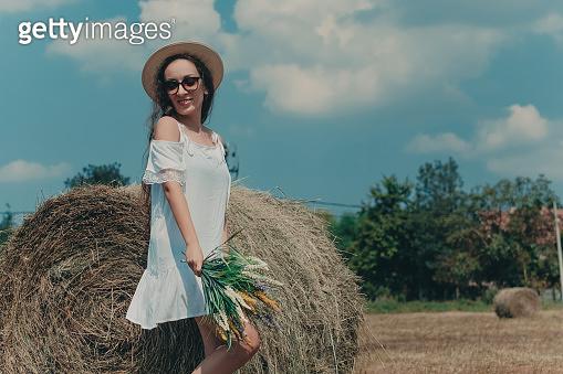 Happy model girl in white dress