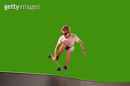 Skateboarder on green screen background