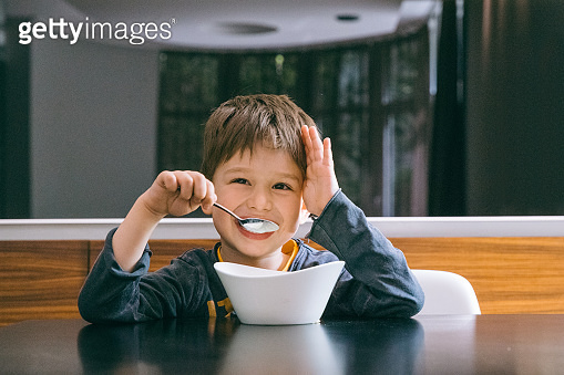 Boy enjoining his food