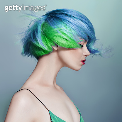 Woman with bright colored flying hair
