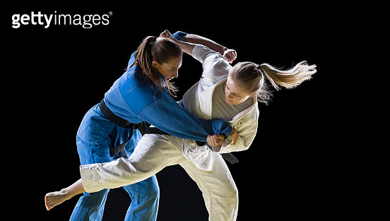 Judo players competing during match