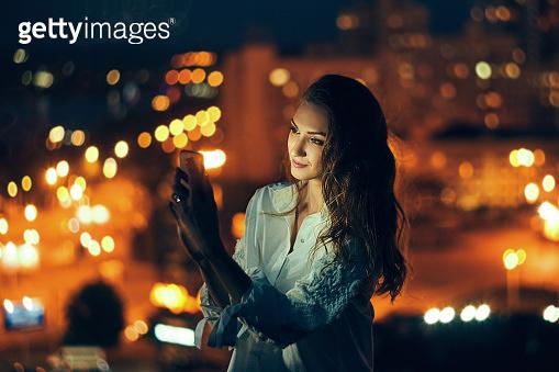Woman over cityscape