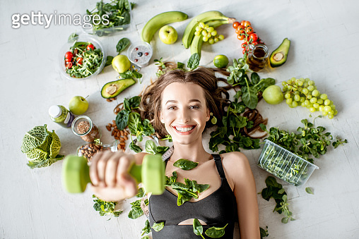 Sports woman with healthy food