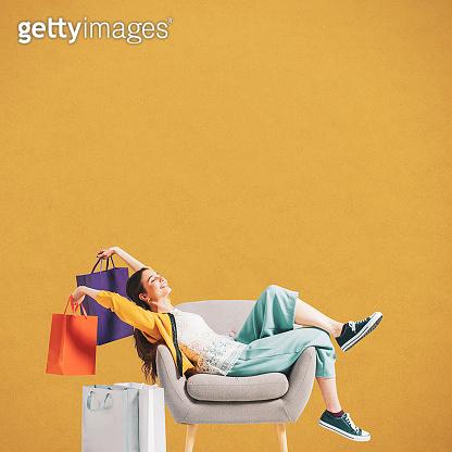 Cheerful shopaholic woman