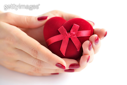 Red heart in woman's hands