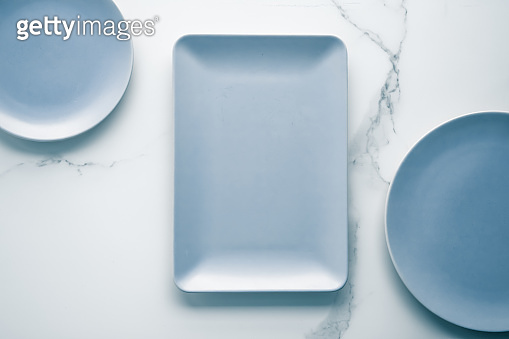 Empty plate on marble